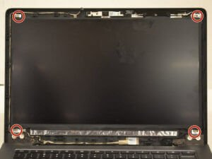 Screws hold the laptop screen to the lid
